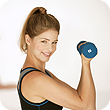 Photo Of A Woman Using Weights For Physical Therapy - Signature Health & Wellness